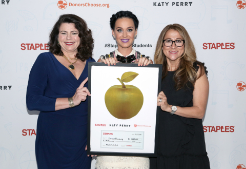 Global pop star Katy Perry, center, with Alison Corcoran, SVP, North American Stores and Online Marketing for Staples, left, and Carolina Martin, SVP, Business Development for DonorsChoose.org, right, hold a plaque containing a donation check at #StaplesForStudents Staples press conference on Thursday, April 21, 2016, in Los Angeles. Continuing its long-standing commitment to celebrating and supporting teachers through the Staples for Students program, Staples teamed up with Katy Perry to announce a $1 million donation to DonorsChoose.org, a charity that has funded more than 700,000 classroom projects and impacted more than 18 million students across the U.S. (Photo: Business Wire)