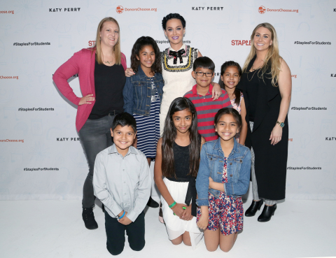 Global pop star Katy Perry, center, pictured with local teachers and students during the #StaplesForStudents press conference on Thursday, April 21, 2016, in Los Angeles. Continuing its long-standing commitment to celebrating and supporting teachers through the Staples for Students program, Staples teamed up with Katy Perry to announce a $1 million donation to DonorsChoose.org, a charity that has funded more than 700,000 classroom projects and impacted more than 18 million students across the U.S. (Photo: Business Wire)