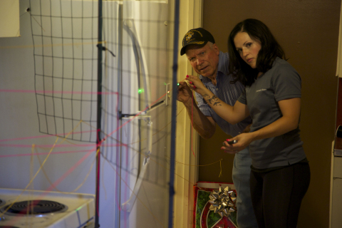 Dub Lawrence and Erna Stewart reconstruct the path of bullets. (Credit: Jared Jakins)