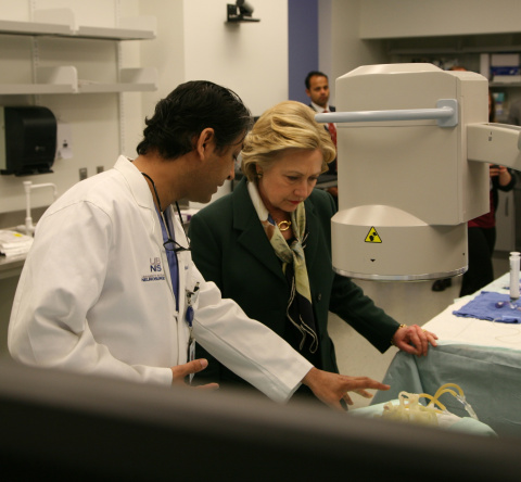 Hillary Clinton examining vascular model produced on a Stratasys Objet500 Connex3 3D Printer with Dr. Adnan H. Siddiqui, Chief Medical Officer, The Jacobs Institute (Photo: Jacobs Institute)