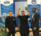 Ryan Fernandez, Pelican Landing Executive Chef (L) and Celebrity Event Judge (R) Congratulate Manny Navarro (C), Executive Chef of Watercrest of Lake Nona on Winning the 2016 One Senior Place Chef's Competition. (Photo: Business Wire)