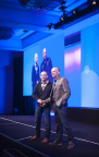 PointClickCare CEO & founder, Mike Wessinger (right) and PointClickCare CTO & co-founder, Dave Wessinger (left) on stage at PointClickCare SUMMIT 2015. (Photo: Business Wire)