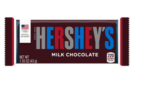 In support of Team USA, the 122-year old Hershey's Milk Chocolate Bar will be taking an unprecedented shift and switching the traditional silver lettering to red, white and blue for the first time in the history of the bar. The Team USA line of products, revealed on Wednesday, April 27th during a special event at Hershey's Chocolate World Attractions in New York City and Hershey, Pennsylvania, are available for purchase for the first time prior to national launch. The suite of patriotic products will be available nationally beginning on May 6, 2016. (Photo: Business Wire)