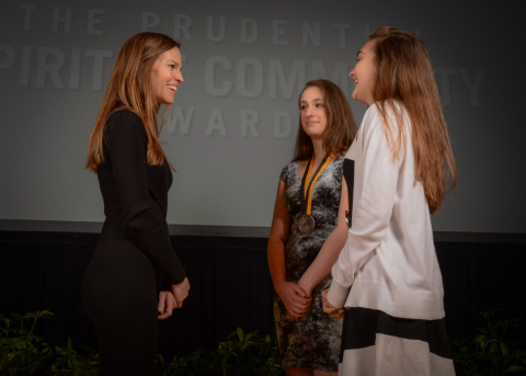 Academy Award-winning actress Hilary Swank congratulates Gavrielle Kamen, 17, (center) and Amelia Myre, 13, (right) both of Washington, D.C., on being named The District of Columbia's top two youth volunteers for 2016 by The Prudential Spirit of Community Awards. Gavrielle and Amelia were honored at a ceremony on Sunday, May 1 at the Smithsonian's National Museum of Natural History, where they each received a $1,000 award. (Photo: Zach Harrison Photography)
