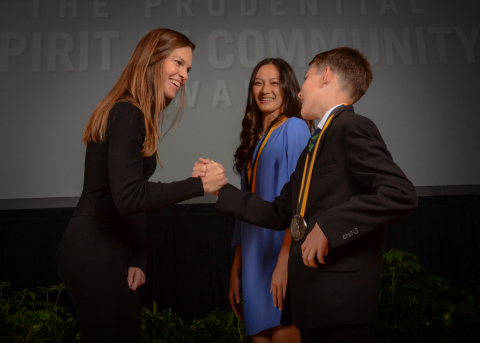 Academy Award-winning actress Hilary Swank congratulates Anna Kimata, 16, of Honolulu (center) and Orren Smith, 11, of Mililani (right) on being named Hawaii's top two youth volunteers for 2016 by The Prudential Spirit of Community Awards. Anna and Orren were honored at a ceremony on Sunday, May 1 at the Smithsonian's National Museum of Natural History, where they each received a $1,000 award. (Photo: Zach Harrison Photography)