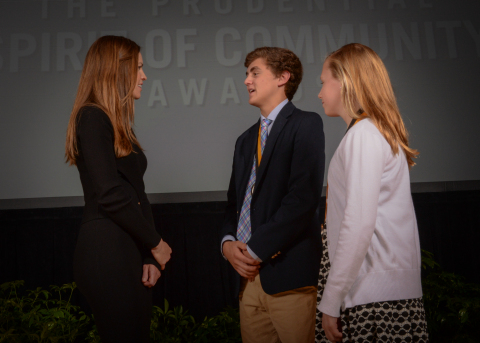 Academy Award-winning actress Hilary Swank congratulates Christian Cole, 18, of Lexington (center) and Grace Davis, 11, of Louisville (right) on being named Kentucky's top two youth volunteers for 2016 by The Prudential Spirit of Community Awards. Christian and Grace were honored at a ceremony on Sunday, May 1 at the Smithsonian's National Museum of Natural History, where they each received a $1,000 award. (Photo: Zach Harrison Photography)