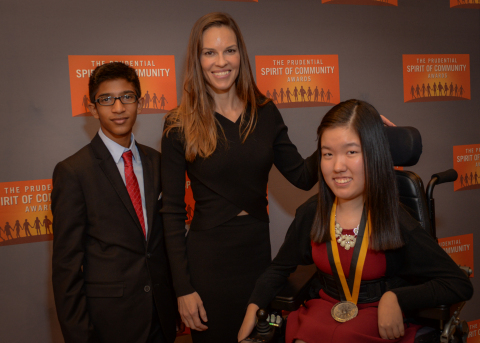 Academy Award-winning actress Hilary Swank congratulates Jungin Angie Lee, 17, of Naperville (right) and Nicolas Ramkumar, 14, of Champaign (left) on being named Illinois's top two youth volunteers for 2016 by The Prudential Spirit of Community Awards. Jungin Angie and Nicolas were honored at a ceremony on Sunday, May 1 at the Smithsonian's National Museum of Natural History, where they each received a $1,000 award. (Photo: Zach Harrison Photography)
