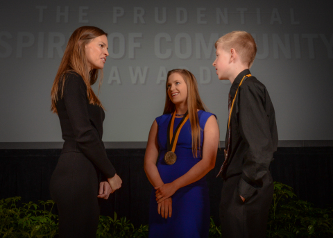 Academy Award-winning actress Hilary Swank congratulates Lauryn Hinckley, 16, of Bismarck (center) and Evan Knoll, 11, of Fargo (right) on being named North Dakota's top two youth volunteers for 2016 by The Prudential Spirit of Community Awards. Lauryn and Evan were honored at a ceremony on Sunday, May 1 at the Smithsonian's National Museum of Natural History, where they each received a $1,000 award. (Photo: Zach Harrison Photography)