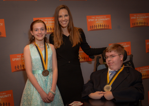 Academy Award-winning actress Hilary Swank congratulates Parker Inks, 17, of Fremont (right) and Meagan Warren, 12, of Bexley (left) on being named Ohio's top two youth volunteers for 2016 by The Prudential Spirit of Community Awards. Parker and Meagan were honored at a ceremony on Sunday, May 1 at the Smithsonian's National Museum of Natural History, where they each received a $1,000 award. (Photo: Zach Harrison Photography)