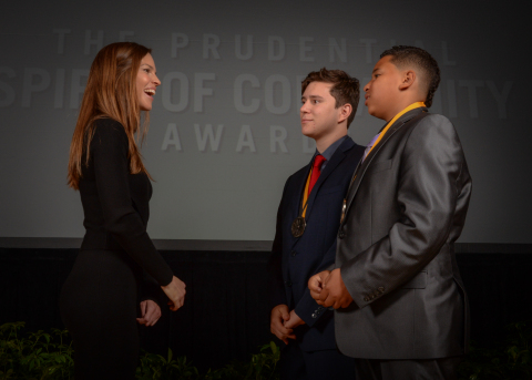 Academy Award-winning actress Hilary Swank congratulates James Lea, 17, (center) and Marquis Jamison, 13, (right) both of Las Vegas, on being named Nevada's top two youth volunteers for 2016 by The Prudential Spirit of Community Awards. James and Marquis were honored at a ceremony on Sunday, May 1 at the Smithsonian's National Museum of Natural History, where they each received a $1,000 award. (Photo: Zach Harrison Photography)