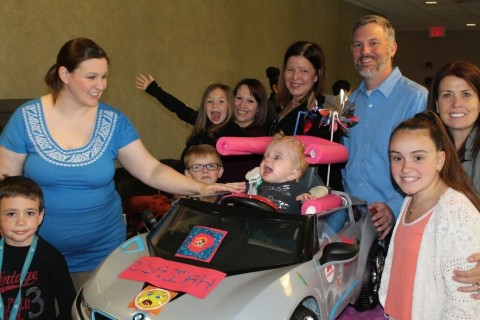 Axalta employees and their children completed the build of a modified, motorized car for a GoBabyGo! family. (Photo: Axalta)