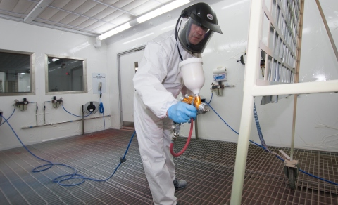 Ian Toole, PPG process application development, Europe, Middle East and Africa, aims a paint spray g ...
