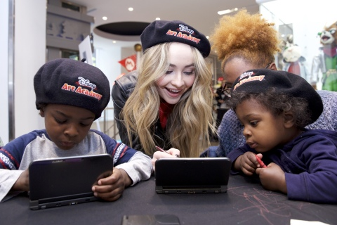 In this photo released by Nintendo of America, actor Sabrina Carpenter, currently starring in the Disney Channel sitcom Girl Meets World, shares her passion for art with fans of the Disney Art Academy video game. The Nintendo 3DS game brings Disney and Pixar characters together on-the-go in a creative, artistic way.