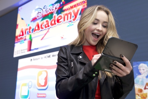 In this photo released by Nintendo of America, actor Sabrina Carpenter, currently starring in the Disney Channel sitcom Girl Meets World, sketches Olaf from Disney Frozen in the Disney Art Academy video game for the Nintendo 3DS family of systems. Whether you're a strong artist or just a beginner, Disney Art Academy can help you create masterpieces of some of your favorite Disney and Pixar characters, which you can then upload and share via Facebook, Twitter and Miiverse.