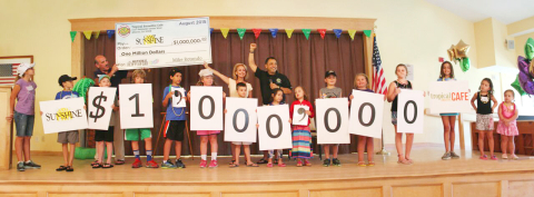 Tropical Smoothie Cafe CEO Mike Rotondo presents $1 million check to the brand's national charity partner, Camp Sunshine. Thousands of children and their families have benefited from the brand's ten-year charitable effort on National Flip Flop Day. (Photo: Business Wire)