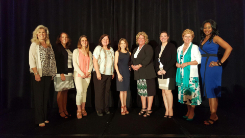 WIN keynote speaker, Gold Medalist and 7-time U.S. Olympian Shannon Miller (center), poses with Axal ...
