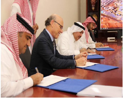 Joint venture agreement signing. The person closest is Eng Adbullah Al-Osaimi followed by David McCo ...