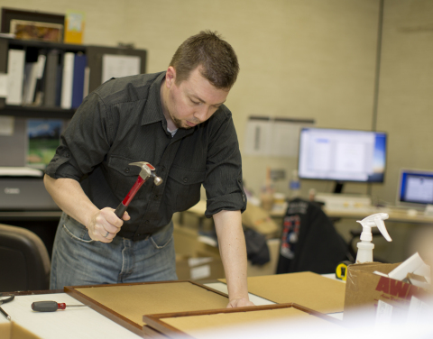 Ryan Keller of Compco Industries in Columbiana, Ohio works on an officer memorial art piece for Nati ...