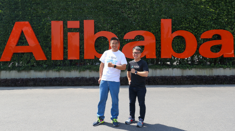 As part of the launch of Fitbit Blaze and Fitbit Alta in China, James Park, Fitbit Co-Founder and CEO, and Zhenfei Liu, Alibaba Partner and Chief Risk Officer, launch new health and fitness focus, 'China is Getting Fit,' at Alibaba's Hangzhou headquarters where more than 500 Alibaba employees participated in a group workout. (Photo: Business Wire)