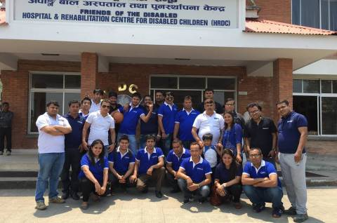 Employees of Opple distributor at the gate of Hospital and Rehabilitation Centre for Disabled Children (Photo: Business Wire)
