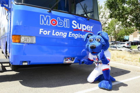 """Mobil Super Mascot """"Mobil Super Sam"""" poses in front of the Mobil Super """"Go The Distance"""" Baseball Tour RV. (Photo: Business Wire)"""