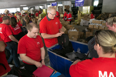 1,100 Staples associates stuffed 20,000 backpacks for local students in need at the Cradles to Crayo ...