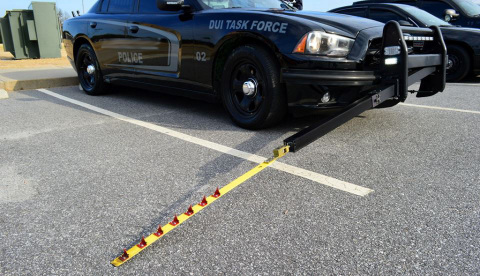 MobileSpike vehicle disablement device deployed on a police cruiser during product beta testing. (Photo: Business Wire)