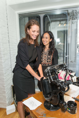 Mariam Naficy and Christy Turlington Burns operating the letterpress at Minted's San Francisco Store (Photo: Business Wire)