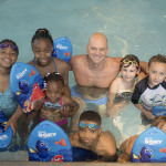 Olympic Gold Medalist and USA Swimming Foundation Ambassador, Rowdy Gaines, gives swim lessons to children at the Princess Anne Family YMCA in celebration of Swimways' fifth annual National Learn to Swim Day, May 21, 2016. (Photo: Business Wire)