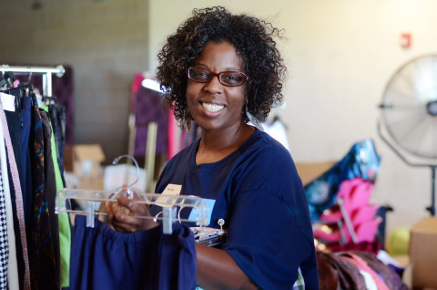 Phoenix employee Alyce Ray helps a Dress for Success client find the right interview outfit during S ...