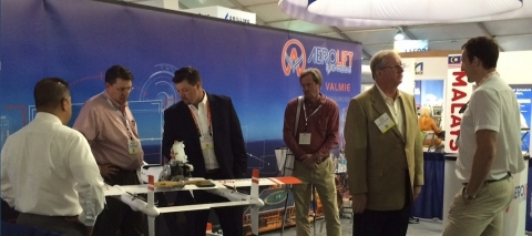 James Stafford (third from left) explains features of AeroLift eXpress transport drone at the Offsho ...