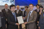 Steven Higgins, European Aviation Safety Agency Section Manager of High Performance Aircraft and Turboprops, presents the EASA type certificate for the HA-420 HondaJet to Honda Aircraft Company President and CEO, Michimasa Fujino.  (Photo: Business Wire)
