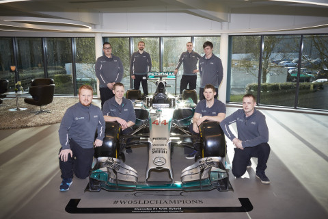 A few members of the MERCEDES AMG PETRONAS Formula One Paint and Graphics Team. (Photo: Axalta)