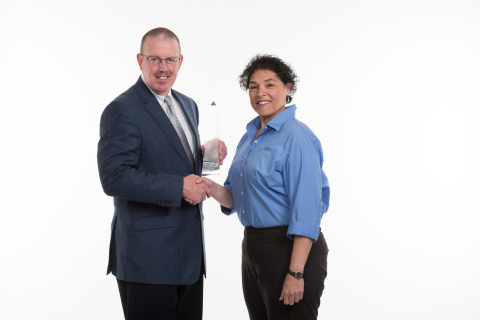 City of Greenwood Village, CO: John Jackson, Chief of Police, receives awards from Nellie De Los Santos, Product Manager, Tyler Technologies (Photo: Business Wire)
