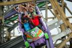 The Joker ride spans 3,200 feet of twisted purple and green track