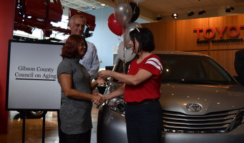 Amy Lindsey, a 14-year production team member at Toyota Indiana, hands the keys to a 2016 Sienna minivan to Michelle Fry, executive director at Gibson County Council on Aging. The non-profit provides transportation to seniors in need. Toyota Indiana also donated a Sienna to Aurora Inc., an organization dedicated to preventing and ending homelessness, in celebration of the plant's 20-year anniversary. (Photo: Business Wire)