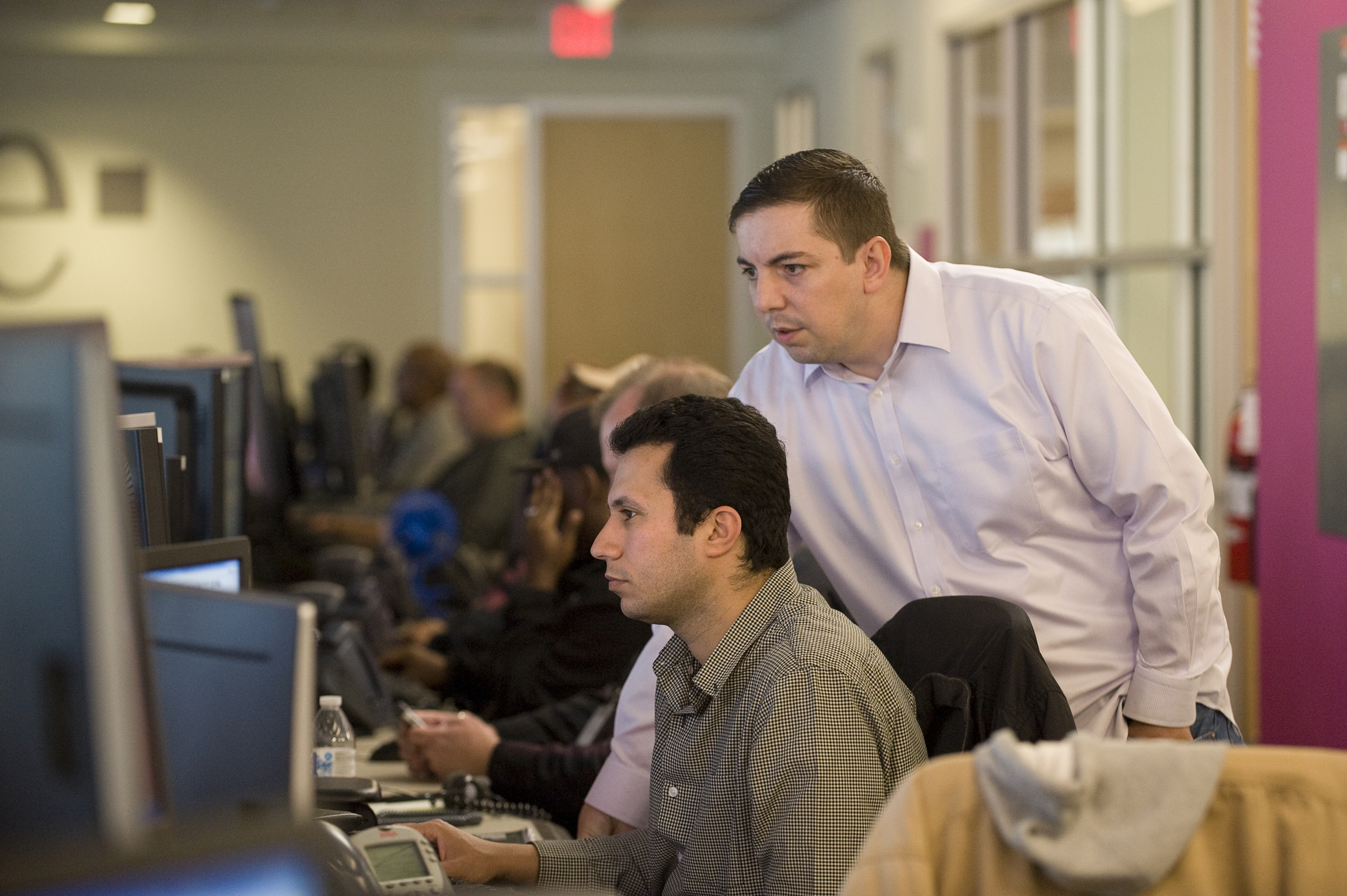 Inside a T-Mobile Network Operation Center: T-Mobile engineers work around the clock at one of the Network Operation Centers (NOCs) to monitor and manage network traffic. (Photo: Business Wire)