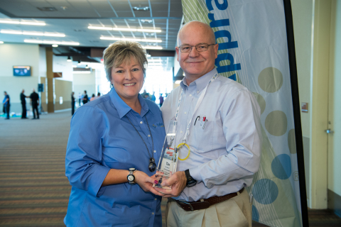 Tim Radloff, Chief Appraiser and Administrator, Lubbock Central Appraisal District, Texas is presented the award by Kim Frisby, Vice President of Support Services, Tyler Technologies. (Photo: Business Wire)