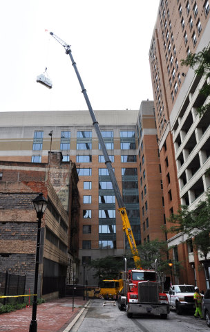 A Crane Hoists One of The Energy Efficient Chillers Up To The Penthouse of The City Crescent Building. (Photo: Business Wire)