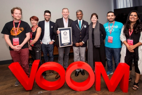 Virgin Media Business Managing Director Peter Kelly is presented with the Guinness World Records title for Longest business pitch marathon (Photo: Business Wire)