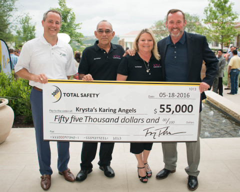 Total Safety CEO Troy Thacker and COO Paul Tyree present a $55,000 check to Krysta's Karing Angels, one of the three beneficiaries of the 2016 Helping HEROES Charity Golf Tournament. (Photo: Business Wire)