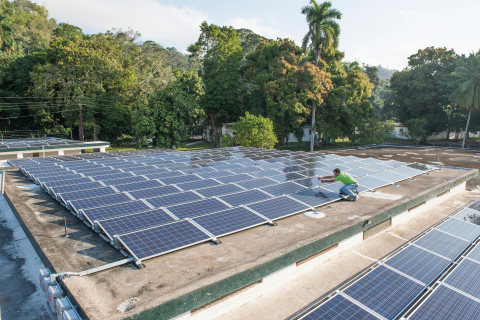 A volunteer with Smucker's Energy of Pennsylvania puts final touches on an installation of SolarWorl ...