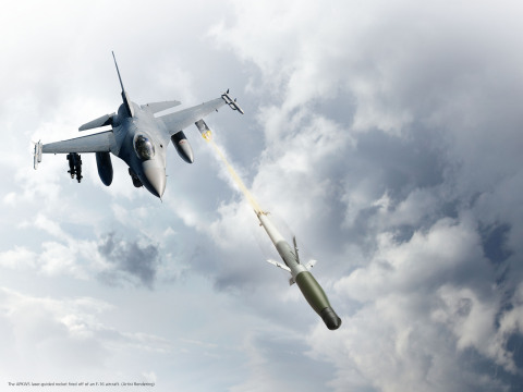 An artist rendering of the APKWS laser-guided rocket fired off of an F-16 aircraft. (Photo: BAE Systems)
