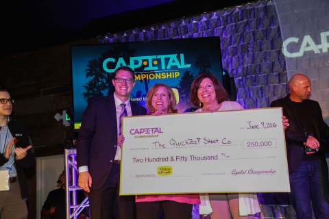 David Brey of Capital Championship, awards the QuickZip Sheet Company owners and founder, Caroline P ...