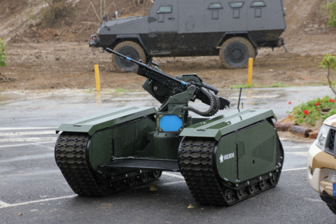 THe first fully modular hybrid unmanned vehicle THeMIS with the wireless remote weapon station ADDER. (Photo: Business Wire)