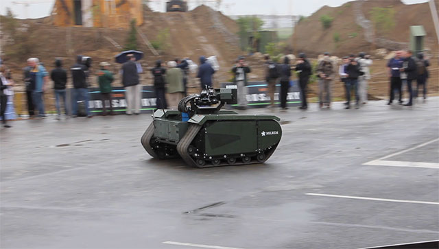 The first fully modular hybrid unmanned ground vehicle THeMIS, developed by Milrem with the wireless remote weapon station ADDER by Singapore Technologies Kinetics.