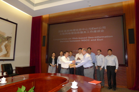 Dean Angelides, Director, International Operations, Esri Inc., and Feng Xianguang from NGCC signed t ...