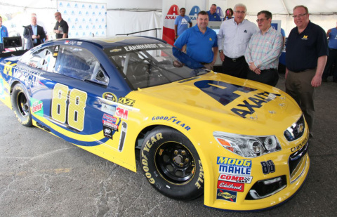 "From left, Axalta's Joseph Campbell and Steven Markevich join GM's Randall Pappal and the University of Michigan's Brian Noble after unveiling the No. 88 Chevrolet SS that Dale Earnhardt, Jr., will drive during the Aug. 28 ""Pure Michigan 400."" (Photo: Axalta)"