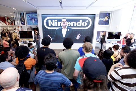 In this photo provided by Nintendo of America, hundreds of Nintendo fans gather at the Nintendo NY store in New York on June 14, 2016, to attend a special event to watch gameplay of The Legend of Zelda: Breath of the Wild via a live stream from this year's E3 video game trade show in Los Angeles. From June 14 to June 19, 500 fans will be among the first people in the world to play The Legend of Zelda: Breath of the Wild for the Wii U console at the Nintendo NY store. During the same six days, Nintendo experts will also offer guided game-play demonstrations on the big screen for fans to watch and enjoy.