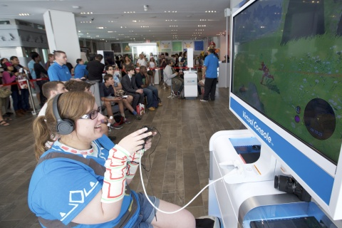 In this photo provided by Nintendo of America, Sarah Niemi of Ashby, Massachusetts, is among the first people in the world to play The Legend of Zelda: Breath of the Wild during a special event at the Nintendo NY store in New York on June 14, 2016. In addition to offering 500 fans the chance to play The Legend of Zelda: Breath of the Wild for the first time at the Nintendo NY store from June 14 through June 19, Nintendo shared its first in-depth look at the game via a live stream from Nintendo's booth at this year's E3 video game trade show in Los Angeles.